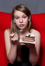 Woman eating pie cheerful a Royalty Free Stock Photography