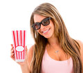 Woman eating popcorn at the movies isolated over a white background Royalty Free Stock Photos