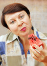 Woman is eating ripe watermelon Royalty Free Stock Image