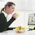 Woman eating salad Royalty Free Stock Photo