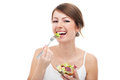 Woman eating salad isolated Royalty Free Stock Photo