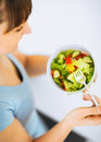 Woman eating salad with vegetables Royalty Free Stock Photo