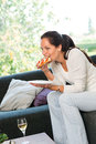 Woman eating sandwich lunch breakfast home sofa Royalty Free Stock Photo