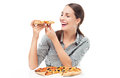 Woman eating slice of pizza young over white background Stock Photography