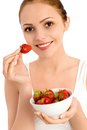 Woman eating strawberries Royalty Free Stock Photo