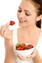 Woman eating strawberries Stock Photos