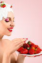 Woman eating strawberry young with hairstyle made from milk red ripe Royalty Free Stock Image