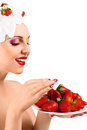 Woman eating strawberry young with hairstyle made from milk red ripe Stock Image