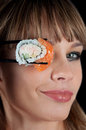 Woman  eating a sushi Royalty Free Stock Photo