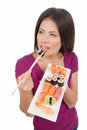 Woman eating sushi top view of beautiful mixed race while isolated on white Royalty Free Stock Photos