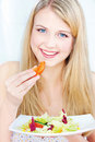 Woman eating tomato Royalty Free Stock Photography