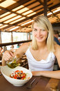 Woman eating vegetable salad Royalty Free Stock Photos