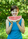 Woman eating watermelon Royalty Free Stock Image
