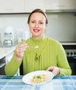 Woman eats rice Royalty Free Stock Photo