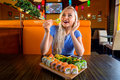 Woman eats traditional sushi rolls. Royalty Free Stock Photo