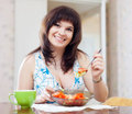 Woman eats veggy salad ordinary Royalty Free Stock Images