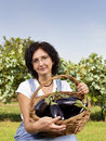 Woman with eggplants Stock Photo