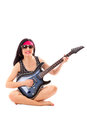 Woman with electric guitar hippie isolated on white background Royalty Free Stock Image