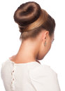 Woman with elegant hair bun portrait of young beautiful creative hairstyle isolated on white background Stock Photos