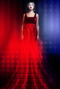 Woman in elegant red dress with American flag Royalty Free Stock Image
