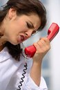 Woman emotionally on the phone young Stock Photo
