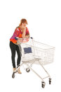 Woman with empty shopping cart red haired isolated over white background Royalty Free Stock Photos