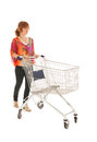 Woman with empty shopping cart red haired isolated over white background Royalty Free Stock Photo