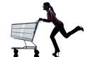 Woman with empty shopping cart silhouette Stock Photo