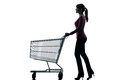 Woman with empty shopping cart silhouette one caucasian in studio isolated on white background Royalty Free Stock Photography