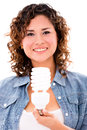 Woman with an energy saving bulb happy isolated over white background Royalty Free Stock Photography
