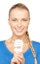 Woman with energy saving bulb picture of attractive Stock Photo