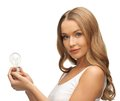 Woman with energy saving bulb picture of beautiful Royalty Free Stock Image