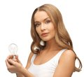 Woman with energy saving bulb picture of beautiful Stock Photo
