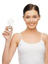 Woman with energy saving bulb picture of beautiful Stock Image