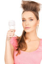 Woman with energy saving bulb picture of beautiful Stock Photos