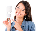 Woman with an energy saving lightbulb holding isolated over white Royalty Free Stock Photos