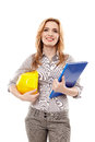 Woman engineer holding a construction plan and a helmet smiling isolated on white background Stock Photography