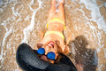 Woman engoying sun and water on the beach Royalty Free Stock Photo