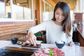 Woman enjoy barbecue in japanese restaurant Royalty Free Stock Photo