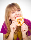 Woman enjoy donut cake. Unhealthy junk food concept