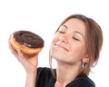 Woman enjoy donut. Unhealthy junk food concept