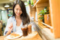 Woman enjoy her food in restaurant Royalty Free Stock Photo
