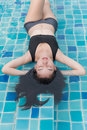 Woman enjoy and relaxing in swimming pool Royalty Free Stock Photo