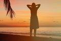 Woman enjoy sunset at tropical beach happy Stock Photo