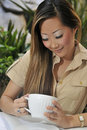 Woman enjoyiing beverage outdoors Royalty Free Stock Photos