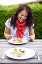 Woman Enjoying an Al Fresco Meal Stock Photo