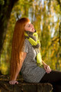 Woman enjoying the autumn sunshine beautiful haired Royalty Free Stock Photography