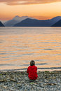 Woman enjoying beautiful sunset landscape on fjord with at the norway Royalty Free Stock Image