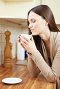 image photo : Woman enjoying coffee