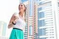 Woman enjoying coffee to go in metropolitan city young drinking dubai Royalty Free Stock Images